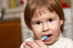 The child cleans teeth Stock Photo