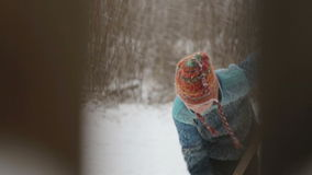 The child cleans track winter. A view through a fence on the cleaning snow teenager stock footage