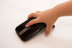 Child Click mouse. Right hand of child with wireless mouse Royalty Free Stock Photography