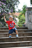 Child climb down stairs Stock Photos