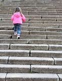 Child climb more stone stairs Royalty Free Stock Photo
