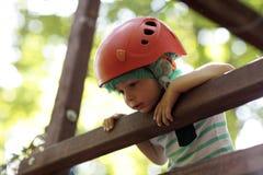 Child climber on a wooden bridge Royalty Free Stock Photo
