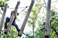 Child in a climbing adventure activity park Royalty Free Stock Images