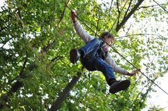 Child in a climbing adventure activity park. Young child having fun  in a climbing adventure activity park Royalty Free Stock Image