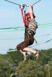 Child climbing in adventure playground Stock Image