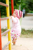 Child climbing on bars. In schoolyard stock image