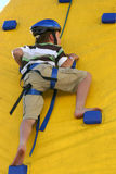 Child climbing a climbing wall Stock Photography