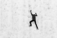 Child climbing frozen waterfall Stock Photo
