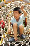 A child climbing a jungle gym. Stock Photography
