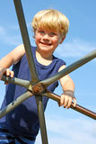 Child Climbing Jungle Gym Stock Image
