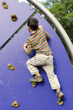 Child climbing at playground Stock Image