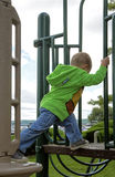 Child climbing on playground equipment Royalty Free Stock Photos