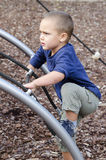 Child climbing at playground Royalty Free Stock Photo