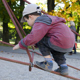 Child climbing at playground Stock Photos