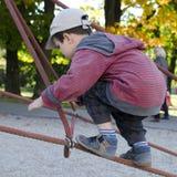 Child climbing at playground stock photos