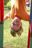 Child on climbing pole 05. Child on climbing pole - head first and laughing Royalty Free Stock Images
