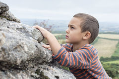 Child climbing on rock Royalty Free Stock Images