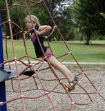 Child Climbing Rope Net. Royalty Free Stock Photography