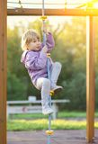 Child climbing rope on playground. Young child climbing rope on playground Stock Photo