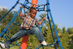 Child Climbing Ropes. Young boy climbing ropes in the park Stock Photos
