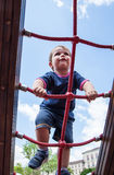 Child climbing ropes in a playground Stock Image