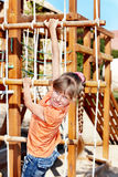 Child climbing on slide. Stock Photos