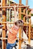 Child climbing on slide. Stock Photos