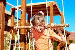 Child climbing on slide. Royalty Free Stock Photos