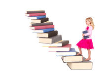 Child climbing staircase of books Royalty Free Stock Photography