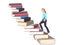 Child climbing staircase of books Royalty Free Stock Photos