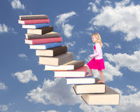Child climbing staircase of books Stock Photos