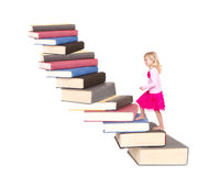 Child climbing staircase of books Stock Photo