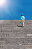 Child climbing stairs. Child boy climbing stairs to success concept Royalty Free Stock Image