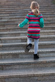 A child is climbing up stairs Royalty Free Stock Photography