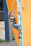 Child climbing up the wall Royalty Free Stock Photography
