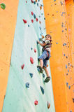 Child climbing up the wall Royalty Free Stock Images