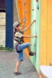 Child climbing up the wall Stock Photos