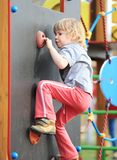 Child on climbing-wall Royalty Free Stock Photos