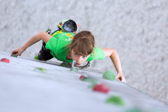 Child on climbing Wall looking up Royalty Free Stock Photography
