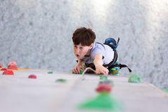 Child on climbing Wall looking up Stock Photo