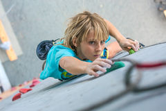 Child on climbing Wall moving up Royalty Free Stock Photos