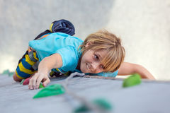 Child on climbing Wall moving up Stock Photography