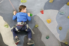Child on climbing wall. Portrait of a child on climbing wall Royalty Free Stock Image