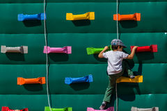 Child on a climbing wall Royalty Free Stock Photos