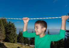 Child climbing. 8 year old child climbing trees in The Austrian Alps Stock Photo