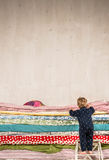 Child climbs on the bed - Princess and the Pea. Royalty Free Stock Photos