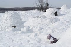 The child climbs out of the snow cave - dwelling Inuit, Igloo royalty free stock images