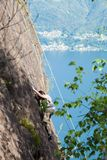 Child climbs on rock wall. Outdoor activities on a beautiful sunny day Royalty Free Stock Photo
