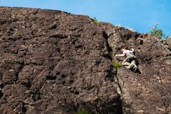 Child climbs on rock wall. Outdoor activities on a beautiful sunny day Royalty Free Stock Images
