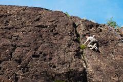 Child climbs on rock wall. Outdoor activities on a beautiful sunny day Stock Images